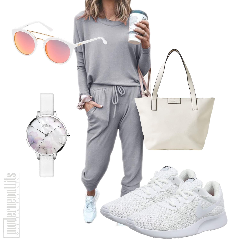 Frauen Trainingsanzug mit Sneakers und Shopper
