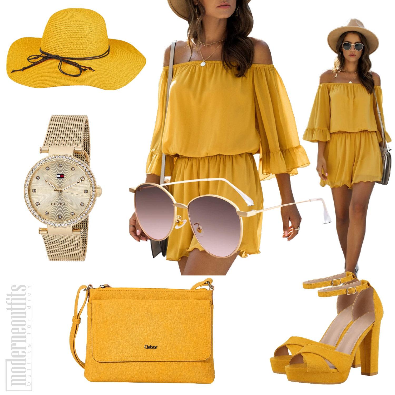 Gelbes Frauenoutfit mit Sommer-Jumpsuit und Hut