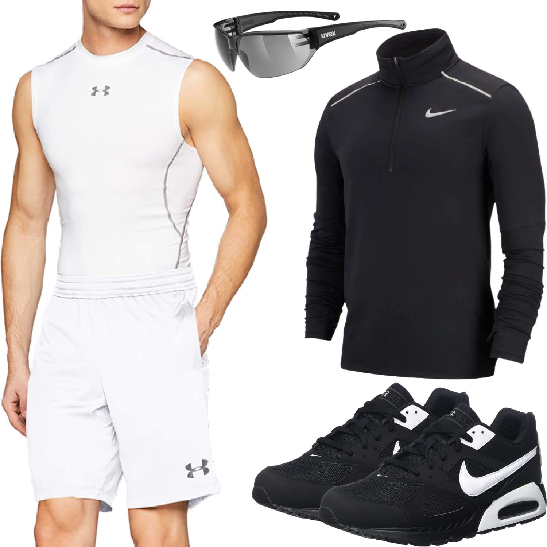 Sportliches Herrenoutfit mit Shorts, Shirt und Laufschuhe